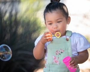 little-girl-blowing-bubbles