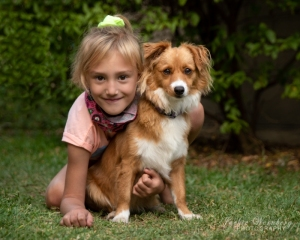 little-girl-posing-with-cute-puppy