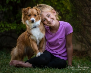 little-girl-posing-with-fluffy-dog