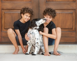 two-boys-and-dog-in-front-door