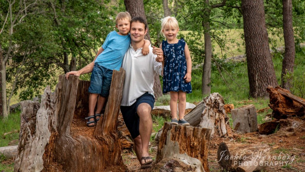Dad and two children in park setting