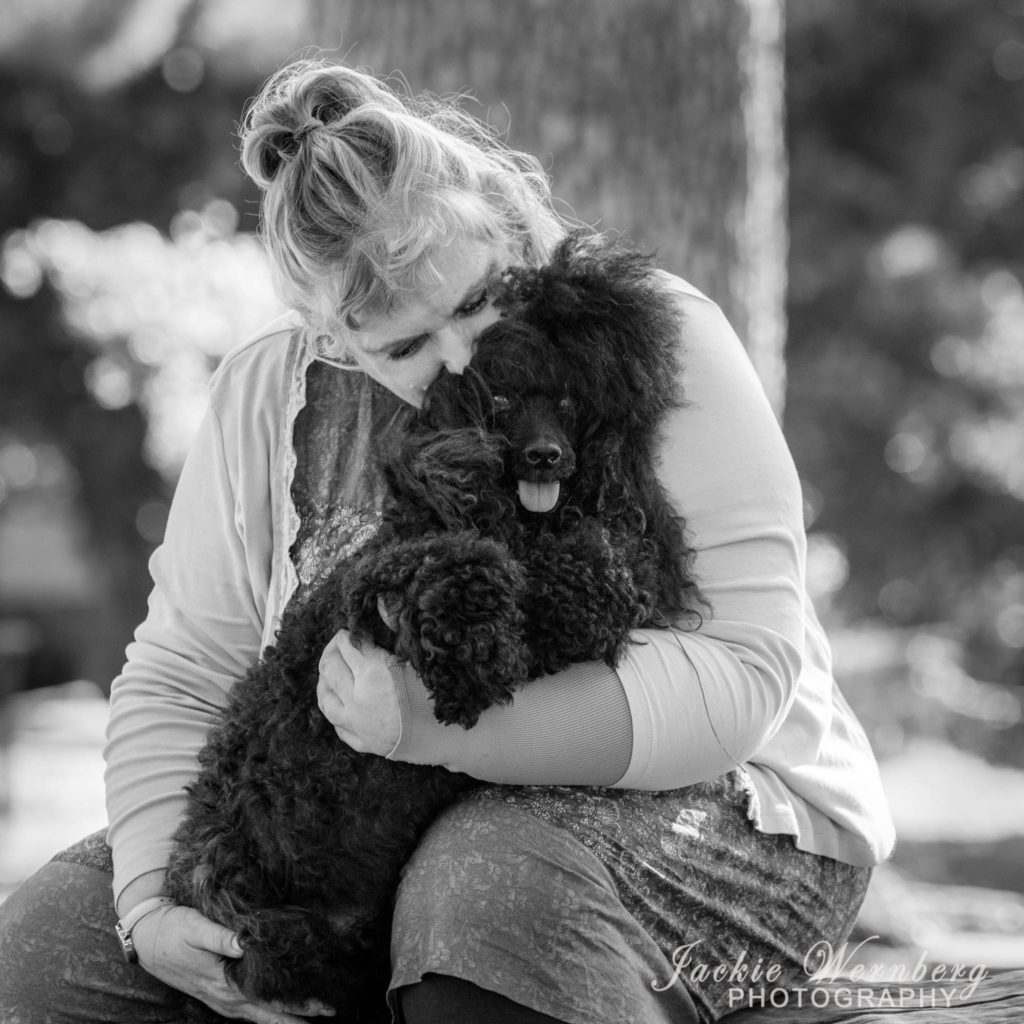 black and white image of owner and dog